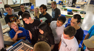 Students gathered around machine